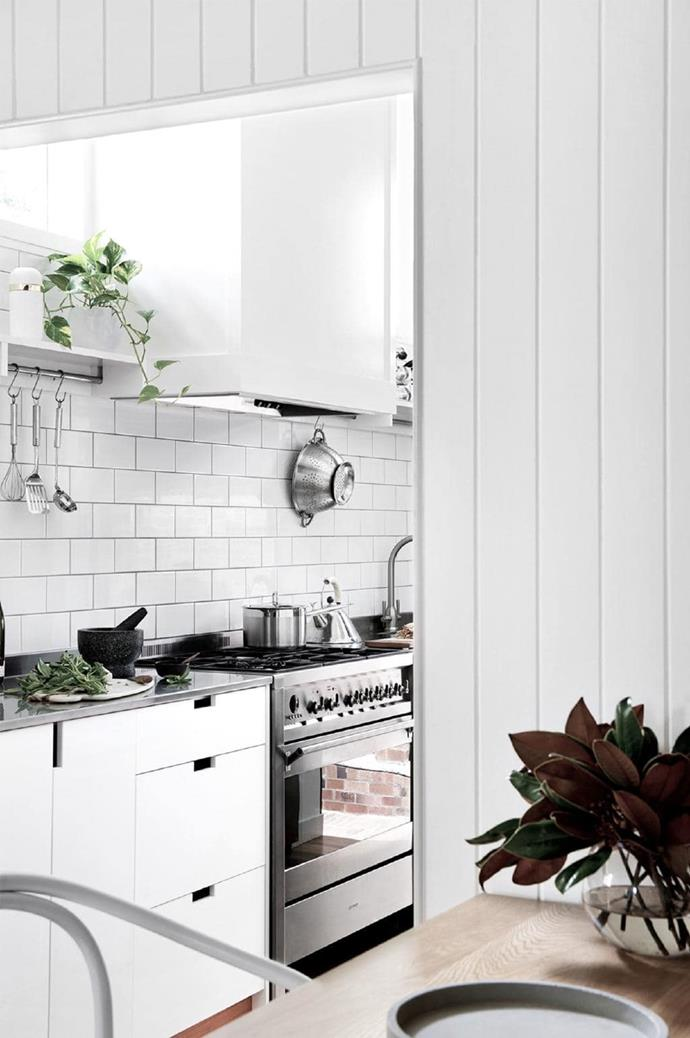 """Crisp subway tiles complement the overarching palette, while the [stainless-steel benchtop](https://www.homestolove.com.au/kitchen-benchtop-guide-19237