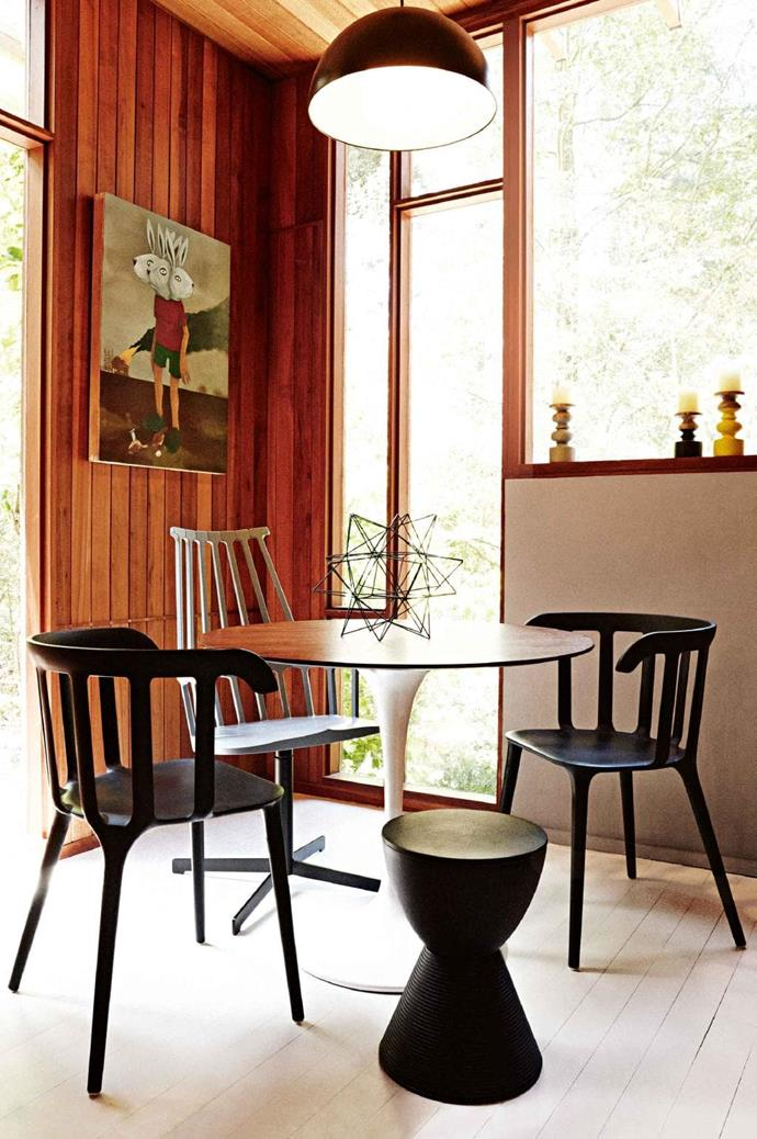A round table provides a sense of balance to a corner dining nook. Different chair styles and colours turn the small space into an interesting one Photographer: Harold David, Stylist: Lara Hutton