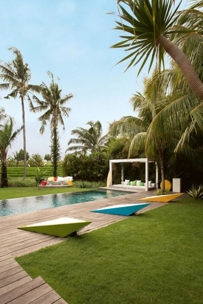 This Balinese home uses an infusion of exotic colours and local architecture for a sunny and carefree approach to pool design Photographer: Felix Forest