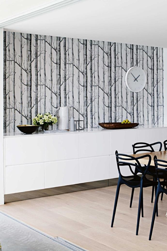 "**CREATE A FEATURE WALL WITH WALLPAPER** <br><br>A beautiful design can do wonders to lift a neutral palette and give a room soul. Cover an entire wall or small section in a design that you're drawn to taking into consideration the mood you want to convey. Here, a wall in [Cole & Son](http://www.cole-and-son.com|target=""_blank""