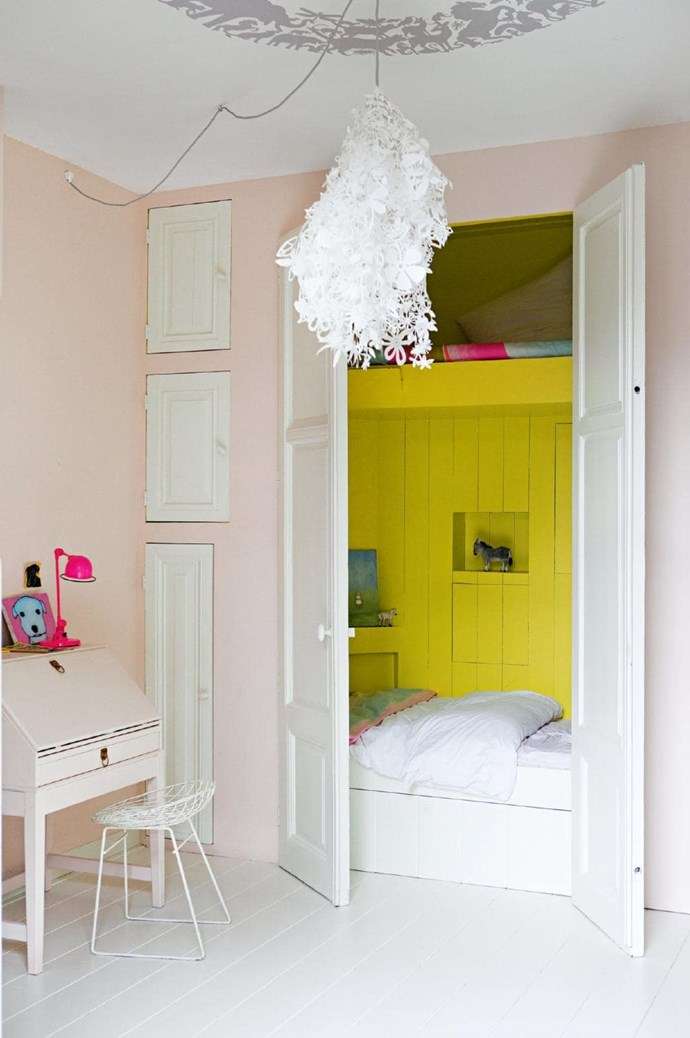 8. Hide & seek. Harry Potter has nothing on this room set-up. This clever bed nook avoids the claustrophobic feel of a wardrobe under the stairs by using a bright yellow tone. Paint definitely lifts this kid's room, with a soft sherbet-pink shade used on the other walls and the desk unit. Tip: Think vertically when integrating storage into small rooms. This recessed sleep zone features built-in storage above and below it, as well as hidey holes for all manner of treasures Stylist: Jessica Bouvy, Photographer: Dana Van Leeuwen