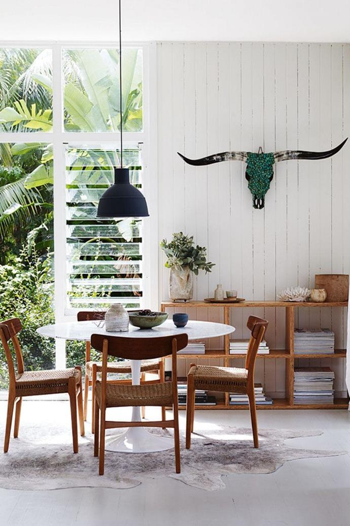 The white tongue-and-groove walls coupled with a lush garden view make for a tranquil dining experience Stylist: Claire Delmar, Photographer: Prue Ruscoe