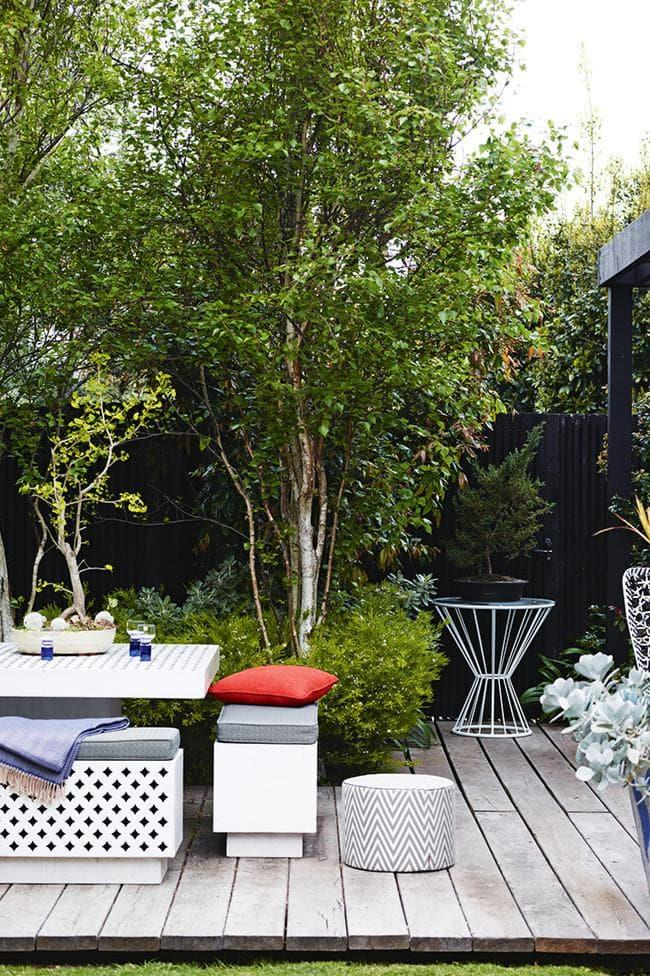 """Take advantage of existing trees by [building decking](https://www.homestolove.com.au/adam-doviles-top-9-tips-to-prepare-for-a-deck-build-16591