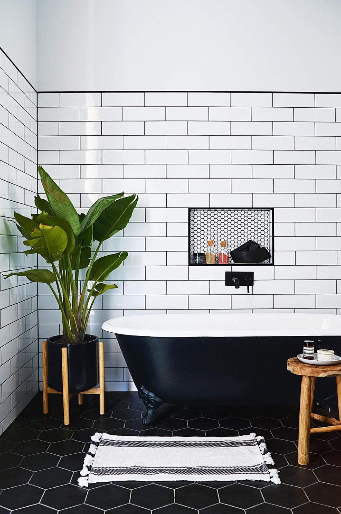 "Subway wall tiles and hexagon floor tiles from BIGA+ Waitara set the scene for dramatic monochrome appeal in the wet zones of a [cosy country farmhouse with modern interiors](https://www.homestolove.com.au/step-inside-this-cosy-country-farmhouse-with-modern-interiors-17468|target=""_blank""). *Photo: Anson Smart / Styling: Jono Fleming / Story: Inside Out*"
