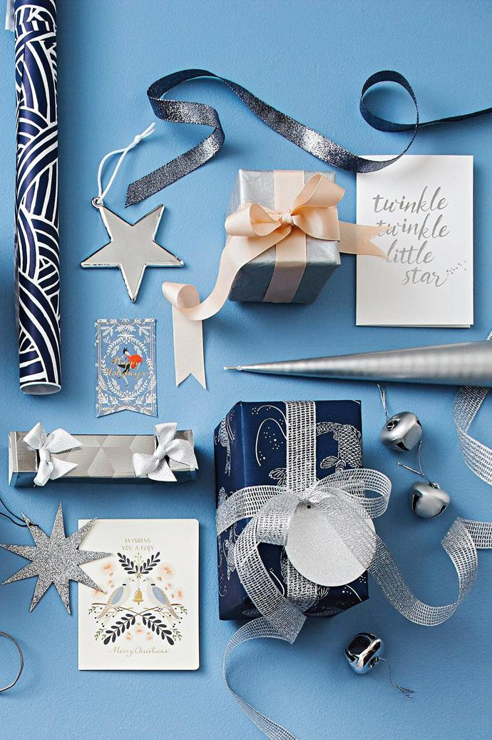 <b>Navy, peach &amp; silver</b> Team midnight blue with soft coral for contrast and finish it off with gunmetal.  <b>Products</b> 'Japanese Wave' wrapping paper in Blue/White, $3/metre, Paper2. 'Noel' star in Silver, $8.95, Country Road. Metallic blue ribbon, peach ribbon and textured silver wrapping paper, Vandoros. 'Twinkle Twinkle' foiled card, $7.50, Papier D'Amour. Ester + Eric candle in Bright Grey, $14.50, Top3 By Design. 'Aria' ribbon in Silver, Vandoros. Dazzling bell ornaments, $14.99/set of 42, Spotlight. 'Vinter' round silver gift tag, $1.99/assorted set of 9, IKEA. 'Koi Fish' wrapping paper, Vandoros. '12 Days Of Christmas Two Doves' Christmas card, $7.95, Bespoke Letterpress. Nordstjerne glitter star ornament, $9, Nordic Rooms. Hand cr&egrave;me bonbon, $14.95, Glasshouse Fragrances. '12 Days Of Christmas Happy Holidays' Christmas gift tag, $14.95/set of 6, Bespoke Letterpress. Background in 'Clean &amp; Protect' low sheen interior paint in Blueberry Cream, $62.50/4L, British Paints.