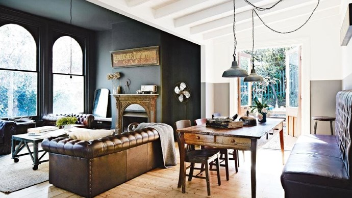 An oversized leather Chesterfield booth seat lends a sense of history and occasion to the space. Industrial pendant lights usher in a more relaxed feel and hang above the table adorned with pieces from [Izzi & Popo](http://www.izziandpopo.com.au/). Stylist: Julia Green | Photographer: Armelle Habib