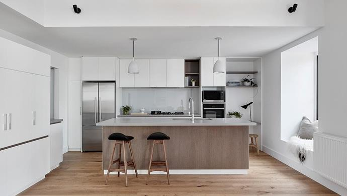 The kitchen includes a [Fisher & Paykel](https://www.fisherpaykel.com/au/kitchen/fridges-freezers/french-door/activesmart-fridge-900mm-french-door-614l.RF610ADX5.html) French door fridge, and a [Neff](https://www.neff.com.au/) oven and cooktop.  Project by [Architect Hewson](https://www.architecthewson.com/), Photography by [Jack Lovel](http://www.jacklovel.com/).