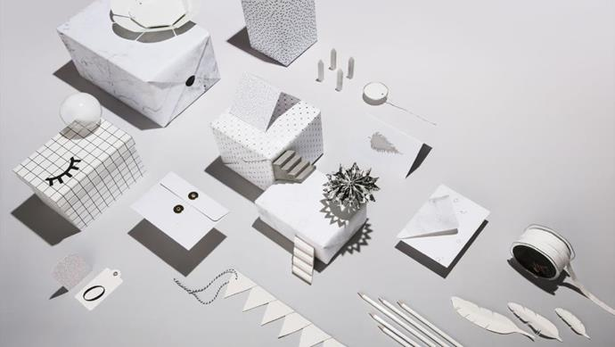 For a minimalist gift wrapping idea, try white on white. Use subtle pattern and accents of black and silver to add layers of interest and detail Stylist: Jessica Hanson & Joseph Gardner, Photographer: Anna Pogossova