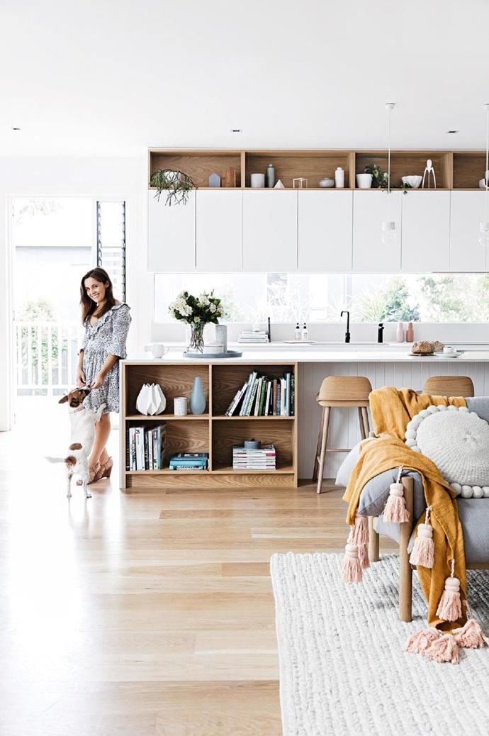 Kitchen: Owner Brooke stands at the expansive island bench with Olive the dog. The joinery and cabinetry were crafted by [Competitive Joinery](https://competitivejoinery.com.au/) Stylist: Kerrie-Ann Jones, Photographer: Maree Homer