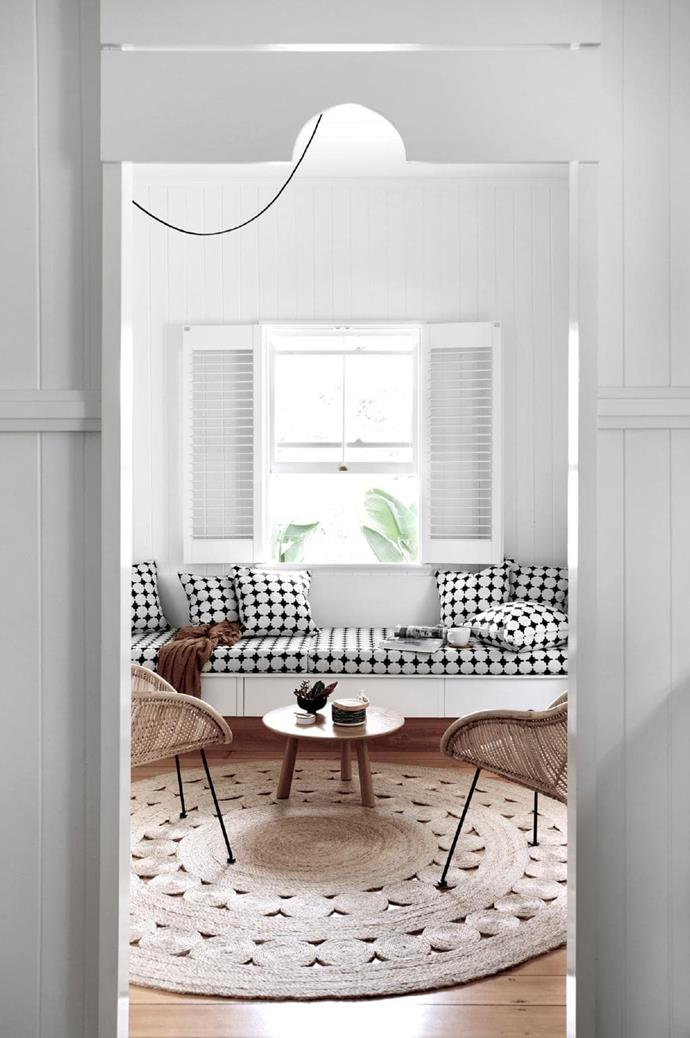 """The banquette-style daybed underneath the window is a space-smart choice, with graphic fabric adding personality. <br><br>**Tip**: Don't overlook storage opportunities – [built-in joinery](https://www.homestolove.com.au/custom-joinery-ideas-18234
