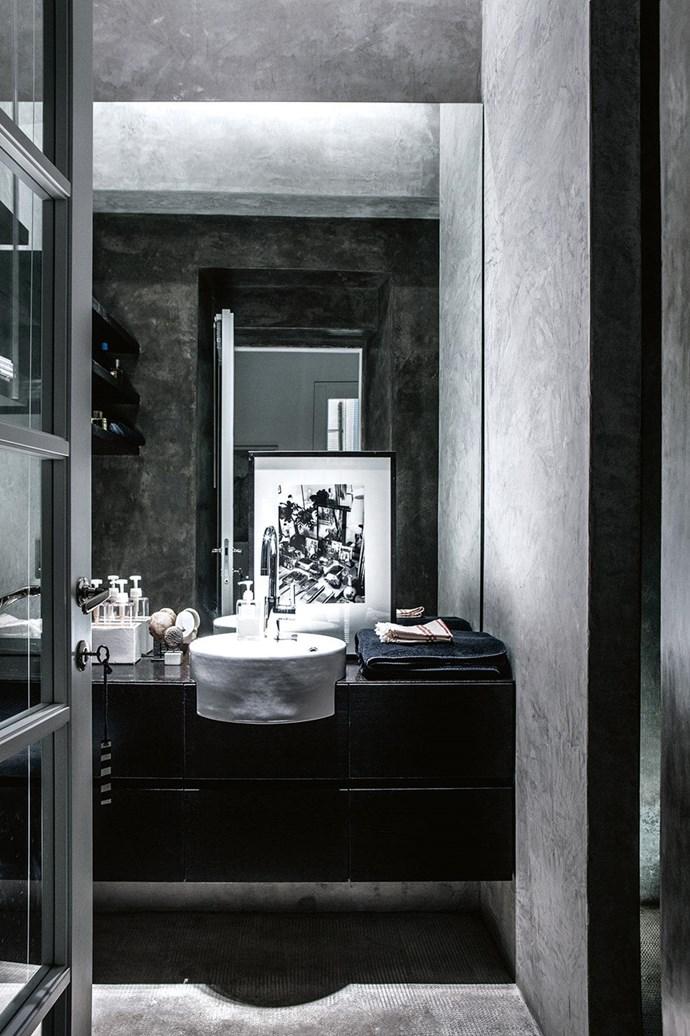 "The cool, matt concrete finish gives the bathroom at a [serene villa on Lake Como](https://www.homestolove.com.au/serene-simplicity-style-inspiration-from-a-lake-como-villa-18539|target=""_blank"") a luxurious feel. Moody black and grey tones create a quiet, calm feeling. *Photographer: Stefania Giorgi*"