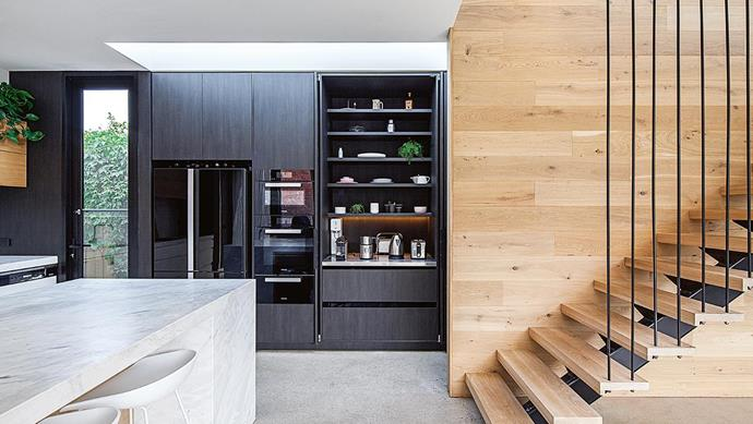 "**APPLIANCE CUPBOARD** <br><br>If, like us, you've fallen in love with the [butler's pantry](https://www.homestolove.com.au/butlers-pantry-design-ideas-17450|target=""_blank""), but space prohibits a walk-in style, try a 'butler's cupboard' to hide small appliances and clutter. Fully retractable pocket doors from Hafele mean you can open it up for easy access during the breakfast rush. ""Make sure the upper shelves are recessed so you can use the area without bumping your head,"" says Sarah Cordy of Cos Interiors, who manufactured and installed the joinery.<br><br>"