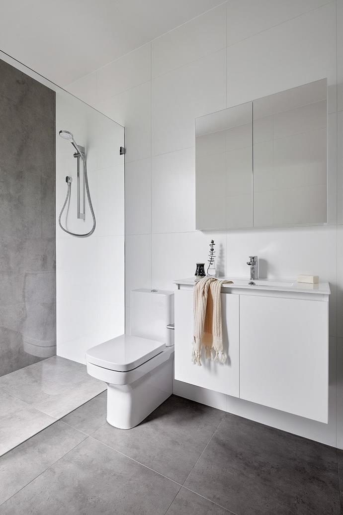 The new bathroom follows the homeowners' brief for deliberately modest style.  Project by [Architect Hewson](https://www.architecthewson.com/), Photography by [Jack Lovel](http://www.jacklovel.com/).