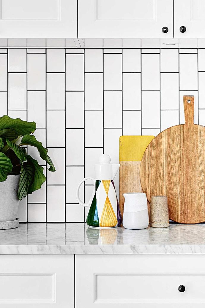 A marble kitchen benchtop sits well with a budget-friendly choice of vinyl wrap polytec instead of 2-pack cupboard doors. Kitchen board, Small Jug by Brooke Thorn and Column Vase by Sophie Moran, all [Modern Times](http://moderntimes.com.au) Photographer: Brooke Holm, Stylist: Marsha Golemac