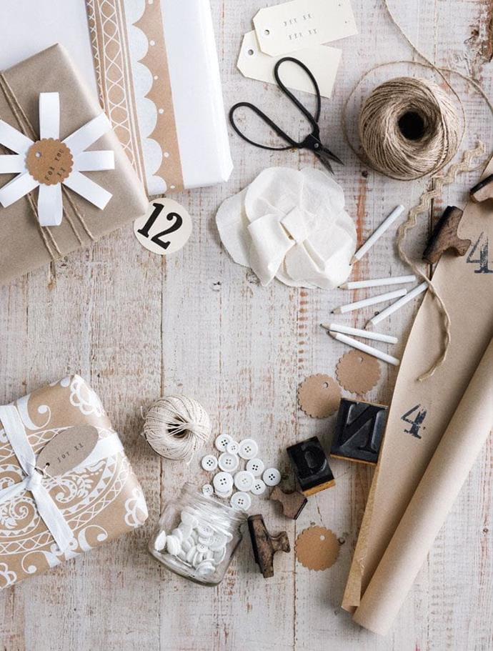 Transform basic brown paper into a beautiful wrapping choice with white ribbon, lace and buttons Photographer: Sam McAdam-Cooper, Stylist: Lara Hutton