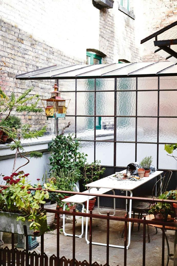 "This slender framed outdoor dining setting is ideal for a small area while a variety of plants provide a cosy setting amongst the roof tops. Image courtesy of [Ikea](http://ikea.com.au|target=""_blank""