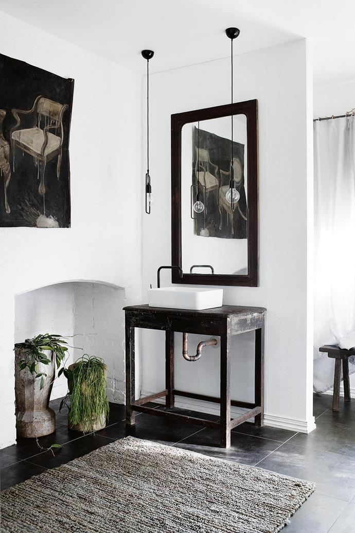 "This bathroom in a [picture perfect heritage cottage](https://www.homestolove.com.au/a-picture-perfect-heritage-cottage-17122|target=""_blank"") features an industrial chic look, and the owners found the vanity in Rajasthan. *Photo: Tara Pearce. / Styling: Jane Frosh*"