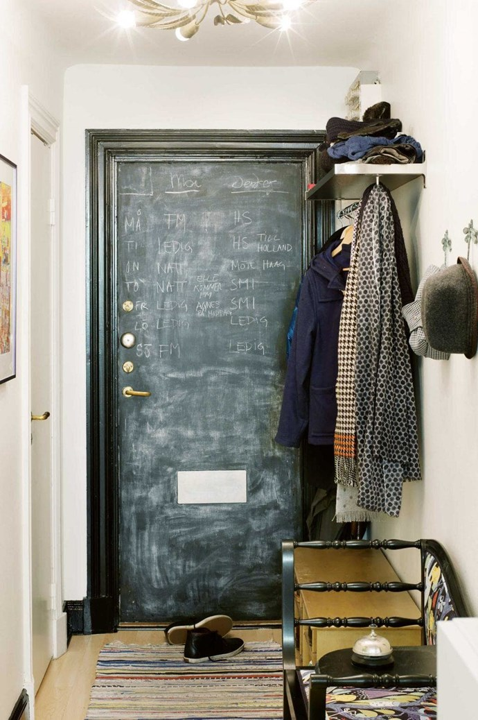The back of this front door was painted in a special finish, creating a handy space for writing notes and schedules. A seat provides a handy drop-off spot for bags and for putting on shoes.