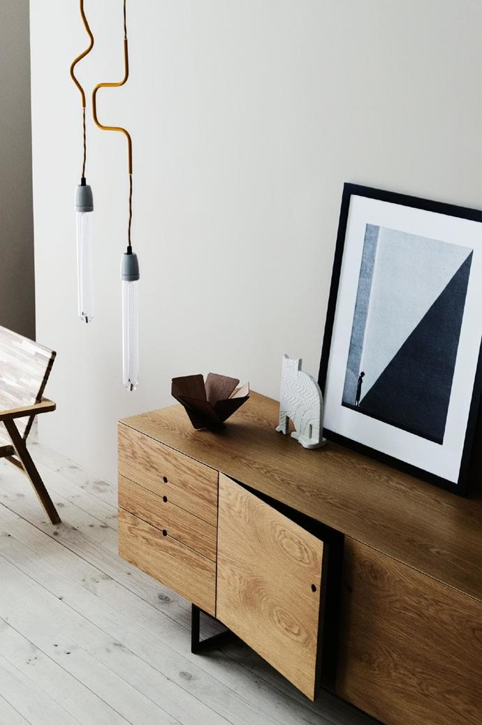 A piece entitled 'Approaching Shadow' by [Fan Ho](http://www.fanhophotography.com/) brings a bold presence to this timber-toned space Stylist: Glen Proebstel, Photographer: Sharyn Cairns
