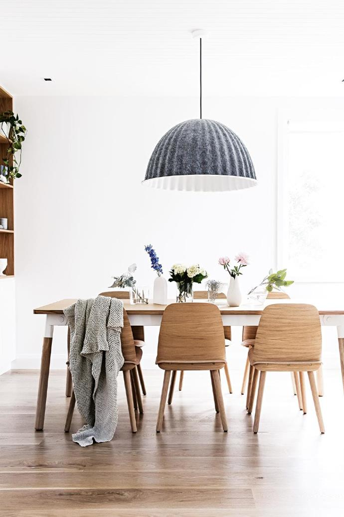 "Dining area: [Scandi style](http://www.homestolove.com.au/8-scandinavian-style-decorating-tips-4290|target=""_blank"") comes to the fore in this space with the [Muuto](https://muuto.com/) 'Under The Bell' pendant light hanging above 'Nerd' dining chairs and 'Adaptable' table Stylist: Kerrie-Ann Jones, Photographer: Maree Homer"
