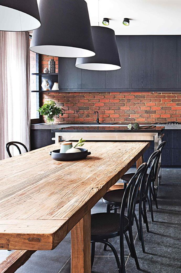 Simple cabinetry and a restrained palette ensure that the exposed brick work is a feature of this kitchen/dining space Photographer: Shannon McGrath