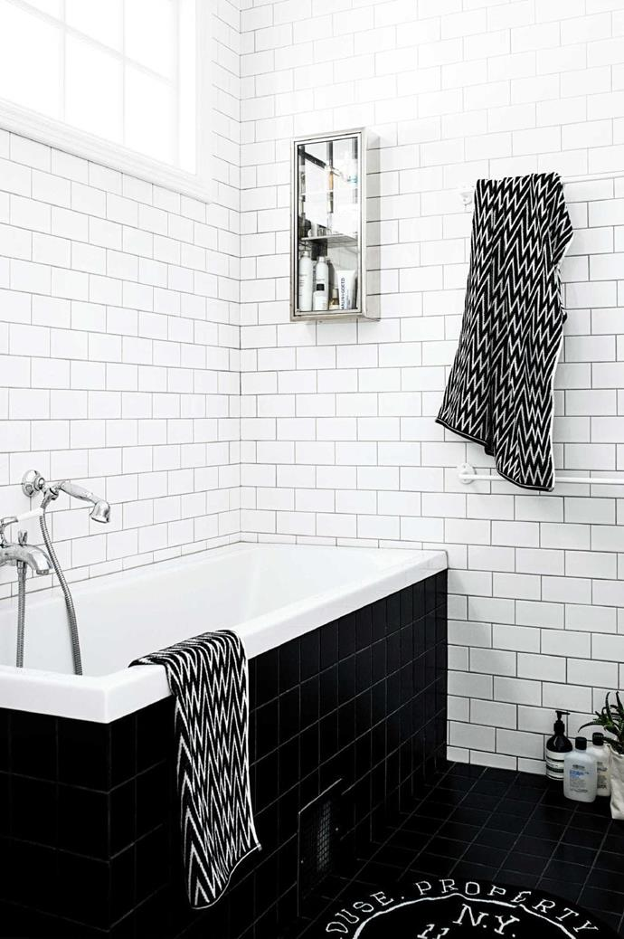 """""""We wanted it to be white and tiled, and simple, relaxing and calming,"""" says Evelina of the bathroom."""