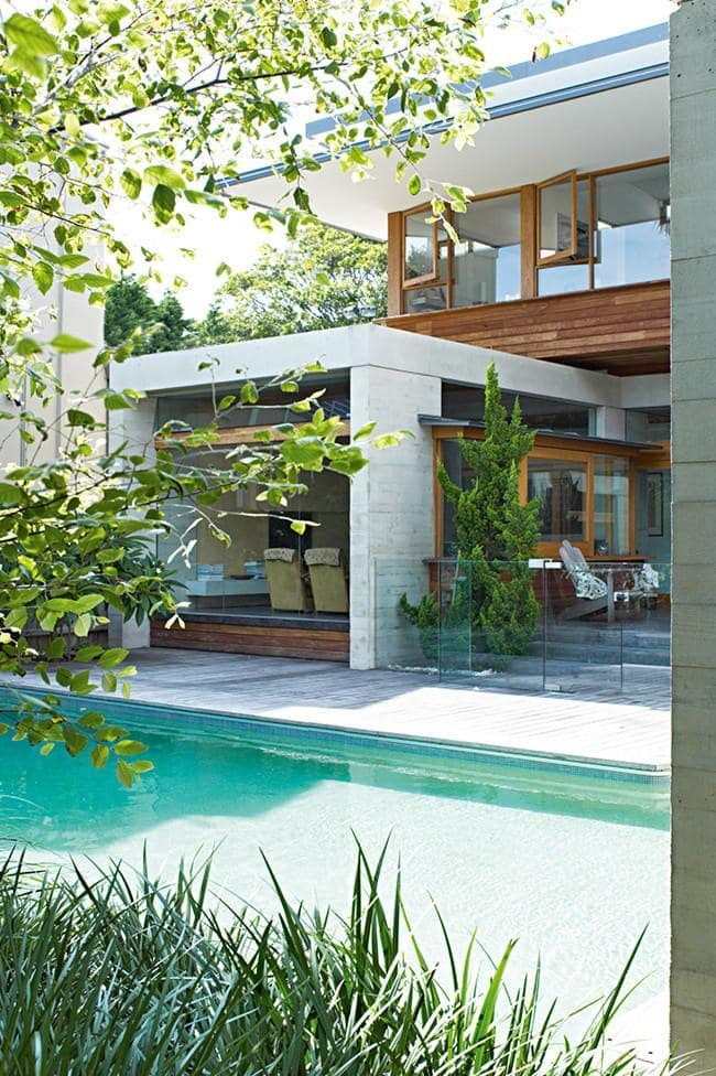 """Extensions When adding a pool, it's all about choosing a design that perfectly suits your home's existing look. Your pool area should be an extension of your home rather than an after thought. """" A way of integrating your pool with its surrounds is to use the same paving or timber used in your house and garden,"""" says Peter Fudge of [Peter Fudge Gardens](http://www.peterfudgegardens.com.au/). Tip: We love an indoor/outdoor poolside entertaining area. Glass sliding doors connect the spaces seamlessly, while also framing the picture-perfect water view Photographer: Prue Ruscoe"""