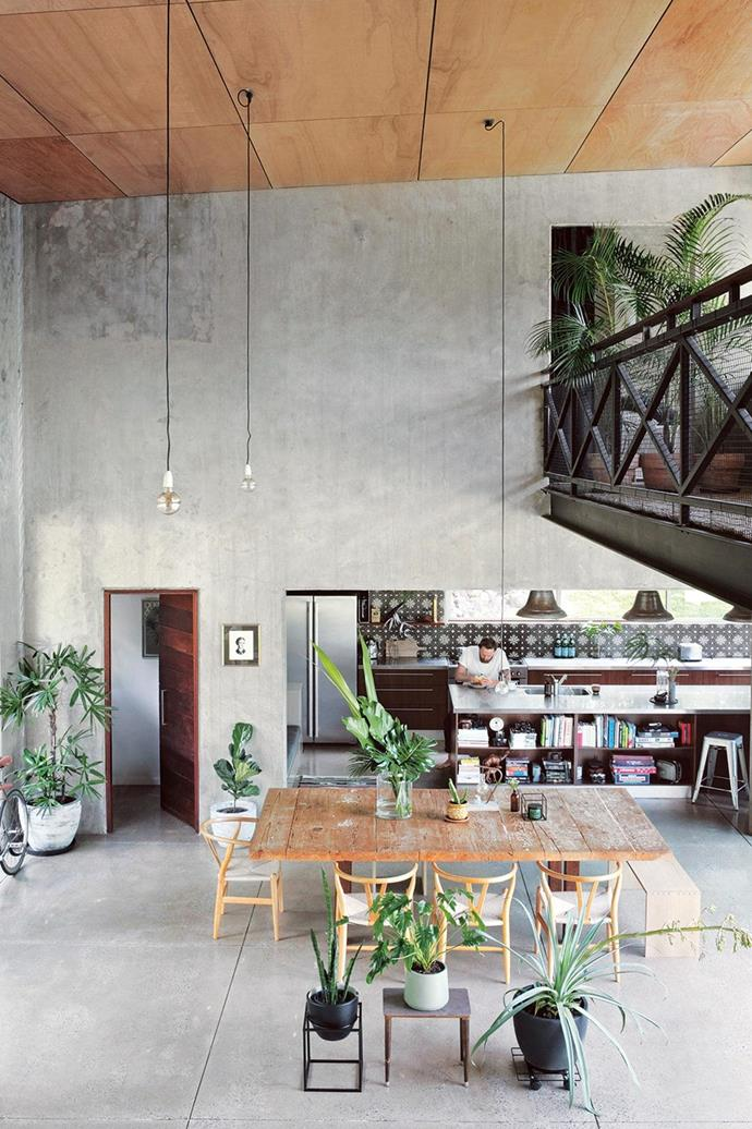 "Surrounded by bushland behind Noosa, this [warehouse style home](https://www.homestolove.com.au/new-build-creative-ideas-from-a-warehouse-style-home-15479|target=""_blank"") provides a mix of urban notes and tranquillity for this creative couple. *Photographer: Anastasia Kariofyllidis*"