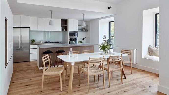 Spaces within the addition were arranged under the pitch according to tasks; in the kitchen and dining area, the ceiling sits low.  Project by [Architect Hewson](https://www.architecthewson.com/), Photography by [Jack Lovel](http://www.jacklovel.com/).