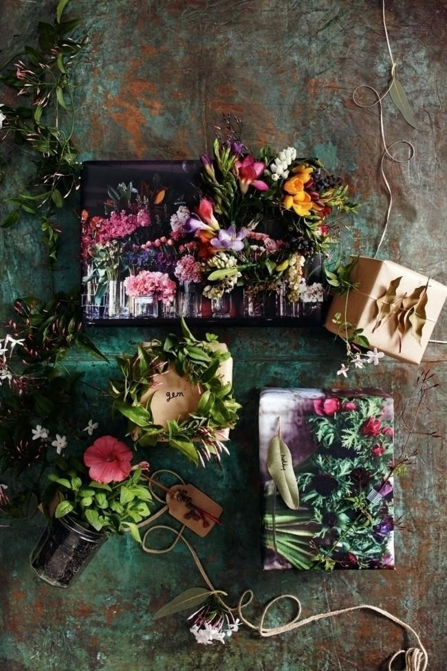 Customise gift tags by dipping pretty twigs or leaves in bright paint, and then adhere them to your tags. Add fresh flowers to your wrapping to complete the look Photographer: Guy Bailey
