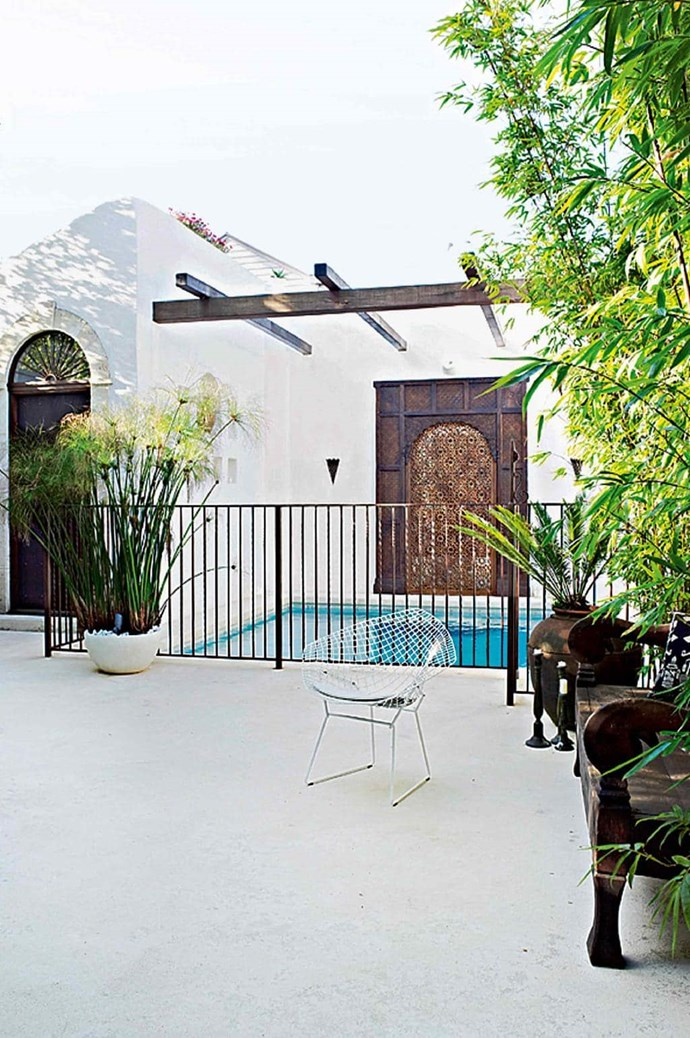 Adobe-inspired walls, ornate carving and timber beams create an exotic and relaxing pool area. Stylist: Glen Proebstel, Photographer: Mark Roper.