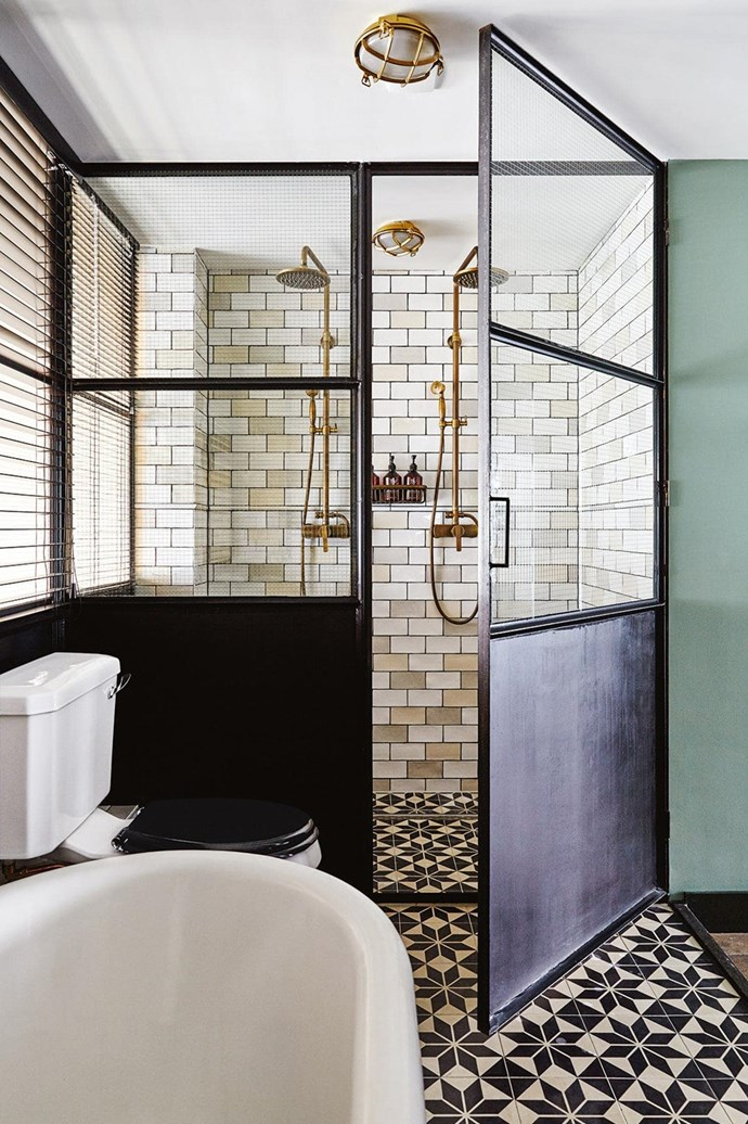 """This bathroom which has an art-deco meets industrial vibe, belongs to an Amsterdam couple who [converted a garage into their dream home](https://www.homestolove.com.au/an-unused-garage-is-transformed-into-an-eclectic-home-filled-with-vintage-treasures-15574