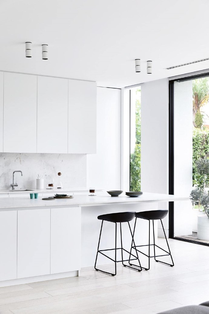**Kitchen** Tam and Wayne went with [CDK Stone's](https://www.cdkstone.com.au/) white Elba marble for a refined elegance in the kitchen. [Hay](http://hay.dk/) stools create an eat-in spot, while white cabinetry provides plenty of storage Photographer: Derek Swalwell, Stylist: Rachel Vigor