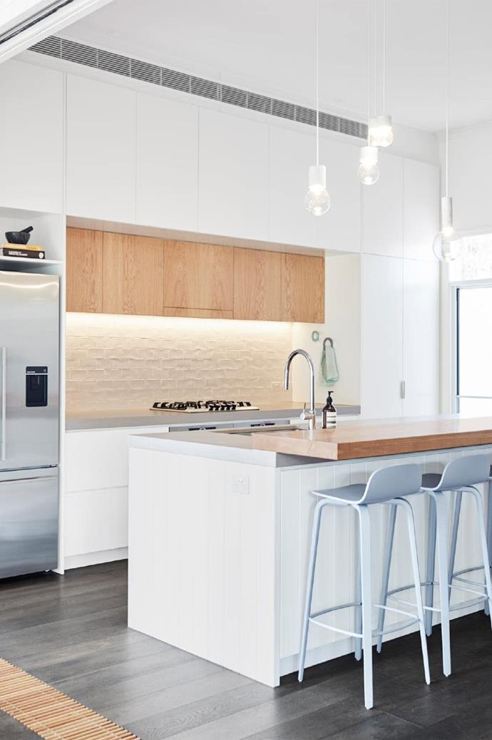 Simple embellishments such as beautiful finishes, new cabinetry and natural materials all give a modern feel and flow to the kitchen.