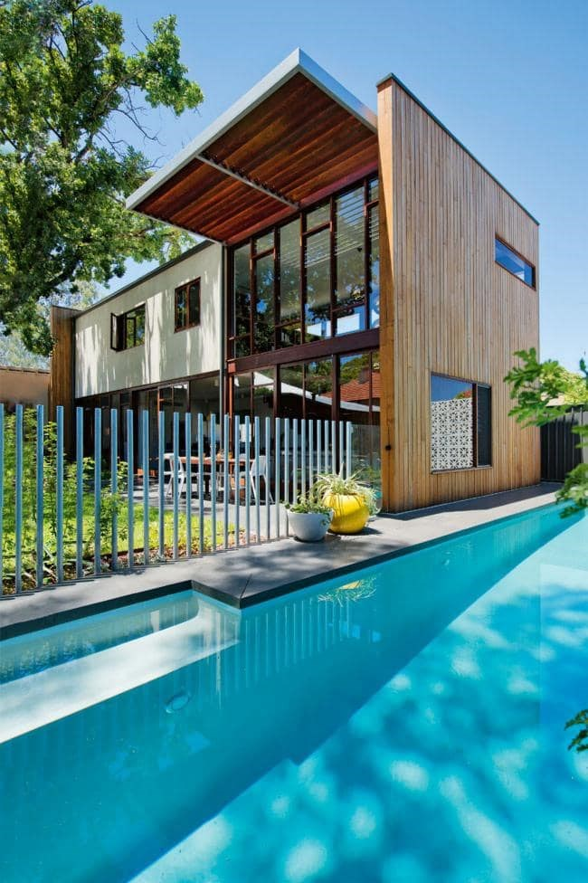 """The modern moat When designing a pool that hugs your existing structures, remember to consider fencing regulations. Buildings can no longer open directly onto a pool area–a vertical fence of a standard 1.2m high needs to be installed. Tip: """"Garden beds and paving that wrap around your house and continue around your pool will unify the pool with the rest of the garden despite the separating fence,"""" says Peter. For the perfect plants for your garden visit [Garden Express](http://www.gardenexpress.com.au/) Photographer: Jody D'Arcy"""