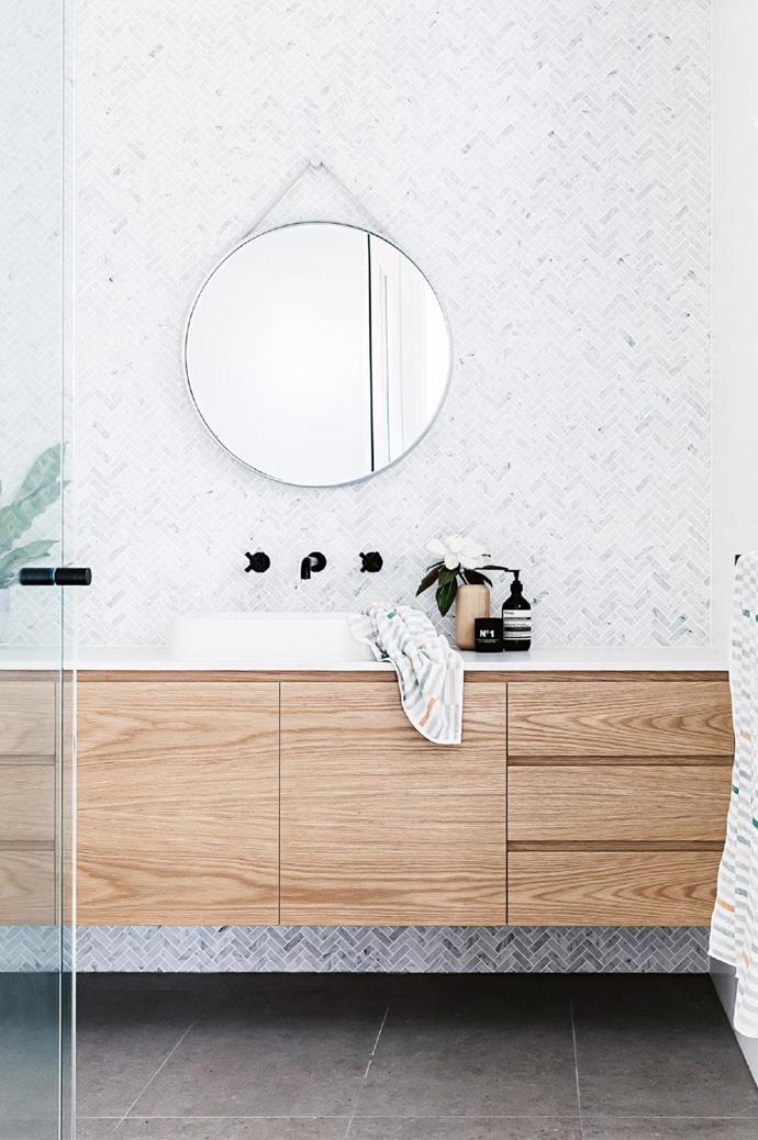Bathroom: Calacatta marble herringbone tiles and concrete-look floor tiles from [Surface Gallery](http://surfacegallery.com.au/) combine with oak veneer cabinetry created by [Competitive Joinery](https://competitivejoinery.com.au/) for a timeless polished look Stylist: Kerrie-Ann Jones, Photographer: Maree Homer
