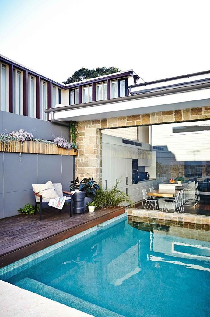 The addition of the pool and alfresco dining area make this backyard a prime spot for entertaining family and friends. Mike also installed LED-lighting to ensure that both people in the kitchen and out in the yard can enjoy the calming garden Photographer: Natalie Hunfalvay, Stylist: Adam Robinson