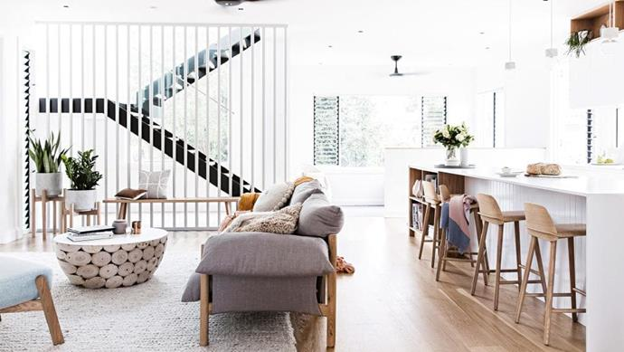 Open-plan living: The staircase can be seen from the front door and the open screen allows light to flow through this central hub. Picture windows with louvres also bring the greenery in. A couple of local furniture stars shine in this living zone with the [Jardan](https://www.jardan.com.au/) sofa and [Mark Tuckey](http://www.marktuckey.com.au/) coffee table. A rug from [Nick Scali](https://www.nickscali.com.au/) provides a soft landing atop American oak flooring Stylist: Kerrie-Ann Jones, Photographer: Maree Homer