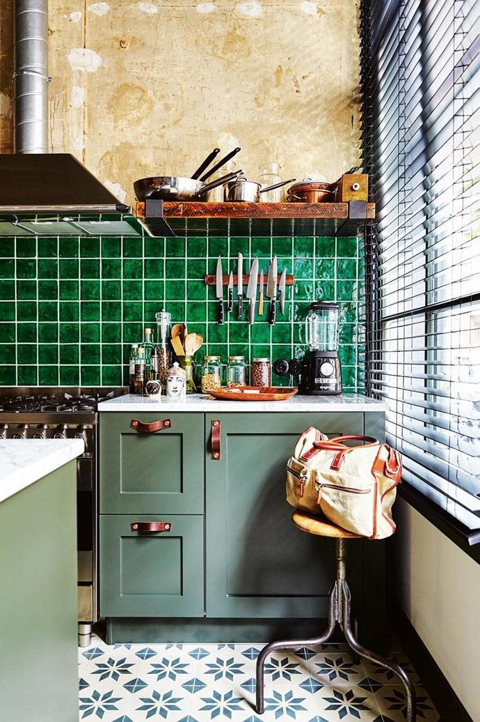 "A creative couple converted a disused garage into an [inviting family home in Amsterdam](https://www.homestolove.com.au/an-unused-garage-is-transformed-into-an-eclectic-home-filled-with-vintage-treasures-15574|target=""_blank"") filled with collected treasures. The compact kitchen, with olive green cabinets and leather pulls, still manages to squeeze in an industrial stool for downing breakfast smoothies. *Photo: Alan Jensen*"