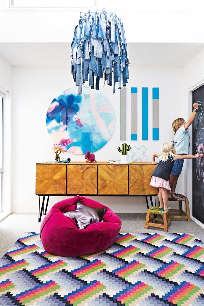 How cool is this denim chandelier? Teamed with a graphic rug and an abstract print, the room is the perfect place for little ones to get crafty themselves Stylist: Julia Green, Photographer: Armelle Habib