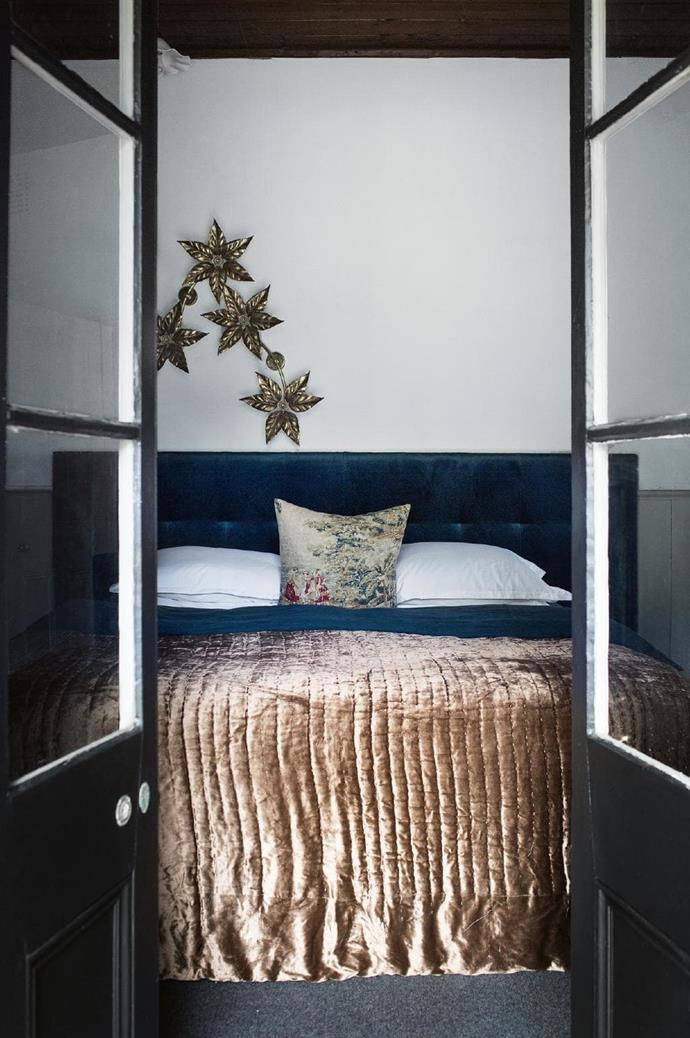 Velvet reigns supreme in the bedrooms. The bedhead, made using velvet from Warwick Fabrics, is a regal partner for the bedspread, found long ago in Jodphur. The vintage wall lamp came from a now-closed shop in Melbourne. Stylist: Jane Frosh, Photographer: Tara Pearce