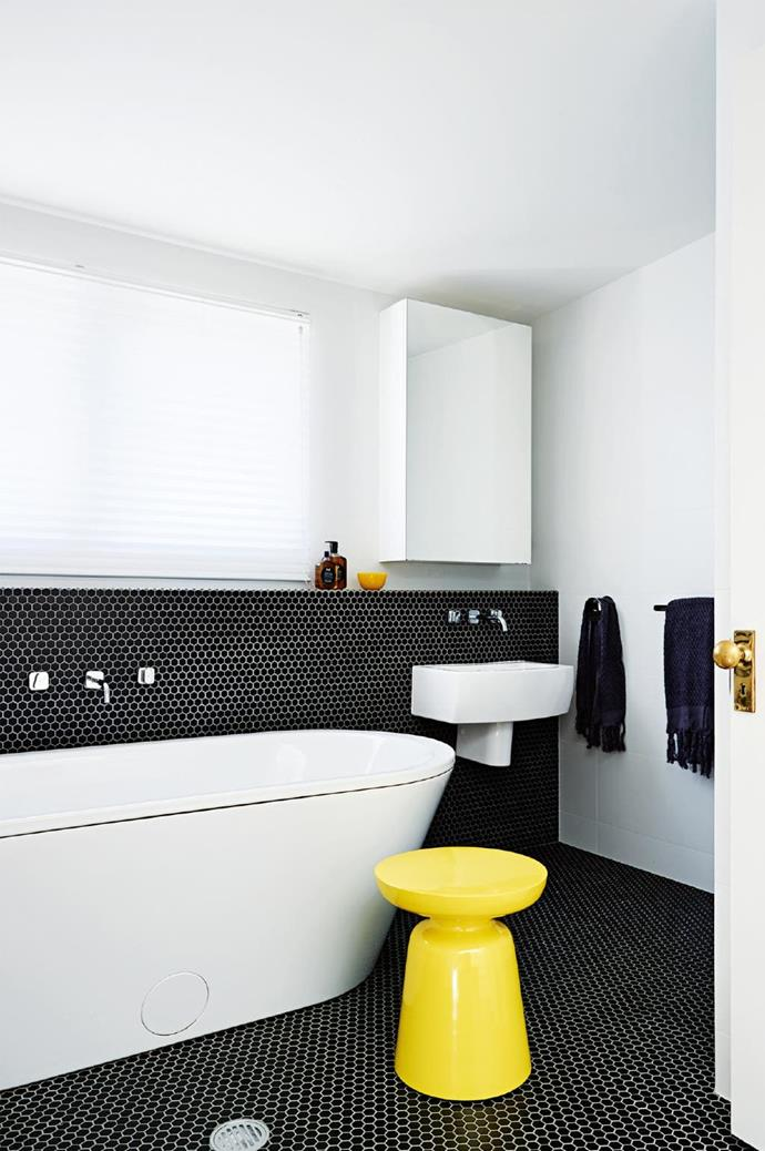 **Dark side**. Kids? Dogs? Muddy work boots? Your first bathroom reno rule is no white floor tiles. Work in a dark and earthy palette, or go all the way with black, which looks super cool with white fixtures. Small tiles help break up the solid colour – choose your grout colour carefully. Designed by [Olga Gruzdeff](http://olgagruzdeff.com/) Stylist: Heather Nette King, Photographer: Anson Smart