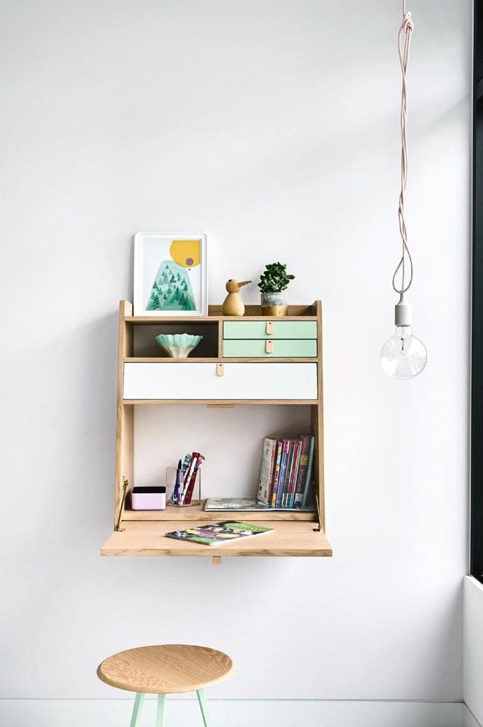 **Zoe's bedroom** AHartô desk folds away to save space and displays treasured items Photographer: Derek Swalwell, Stylist: Rachel Vigor