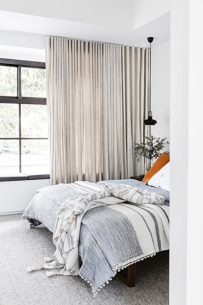 "**Sitting pretty** This bedroom features a [window seat](https://www.homestolove.com.au/window-seats-7061|target=""_blank"") with hidden storage. ""I try to include as much storage as I can and make it as invisible as possible,"" says architect Jeremy Bull. *Design: [Alexander&Co](https://alexanderand.co/
