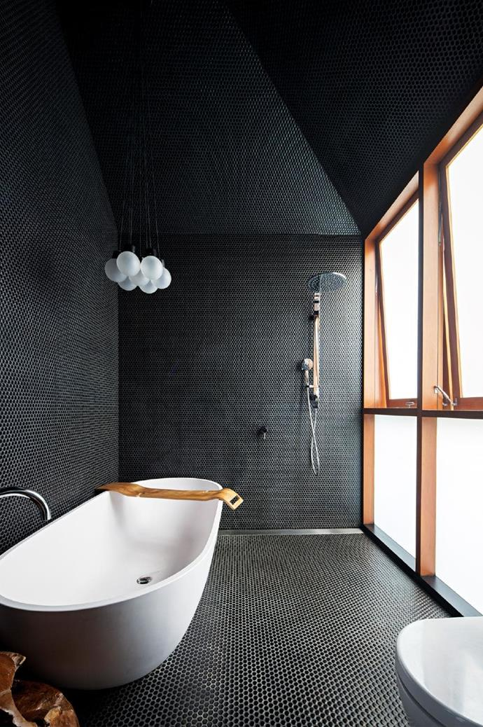 **Drama queen**. Striking and elegant, this all-black bathroom is an escape from the world. A deep bath, mood lighting and a generous showerhead (with handy railshower attachment) combine for a wet room with attitude. If you're into this look, make sure you have enough natural light to carry it off and include some warm timber elements. Don't forget a tray for a glass of vino and a good book, too. Designed by [Carterwilliamson Architects](http://www.carterwilliamson.com/) Photographer: Brett Boardman