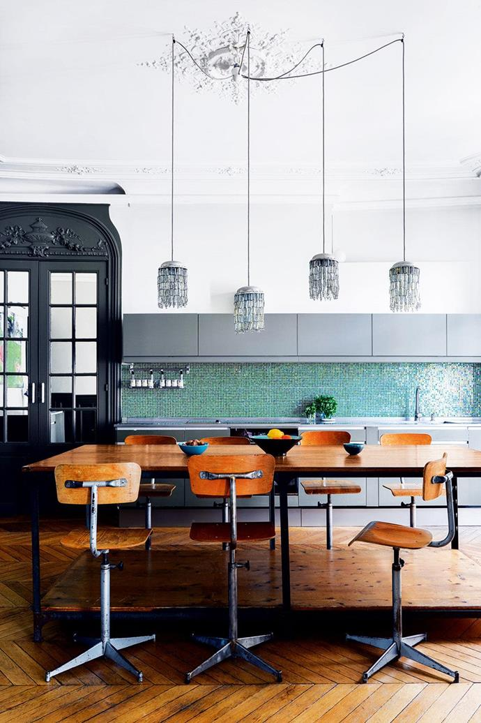 "This [eclectic apartment in Paris](https://www.homestolove.com.au/a-classic-parisian-apartment-is-reinvented-with-colour-15192|target=""_blank"") is centred around a colourful kitchen which daringly contrasts industrial style furnishings against classic period features. *Photo: Germain Suignard*"