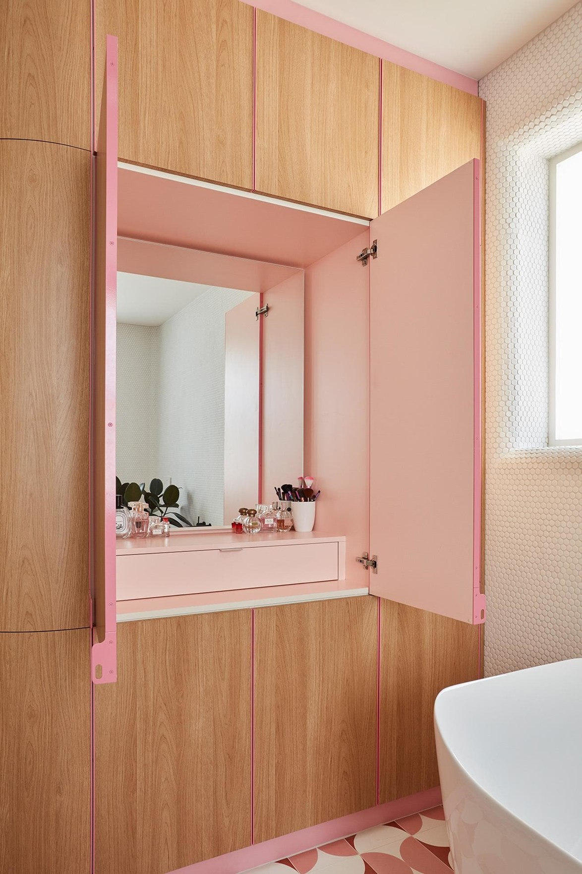 "**Bespoke bathroom storage** - Face-level and under basin storage have been bathroom design buzzwords for years. From toiletries to hairdryers and makeup collections, there's quite a lot that needs to be packed away in a bathroom (especially if you're after that always tidy, minimalist aesthetic). A clever bathroom cabinet in an [updated 19th Century terrace house](https://www.homestolove.com.au/this-renovated-19th-century-terrace-now-has-pastel-pink-floors-and-secret-doors-17195|target=""_blank"") fits the bill *and* is a delight to pop open.  *Photo: Sean Fennessy / Story: Inside Out*"