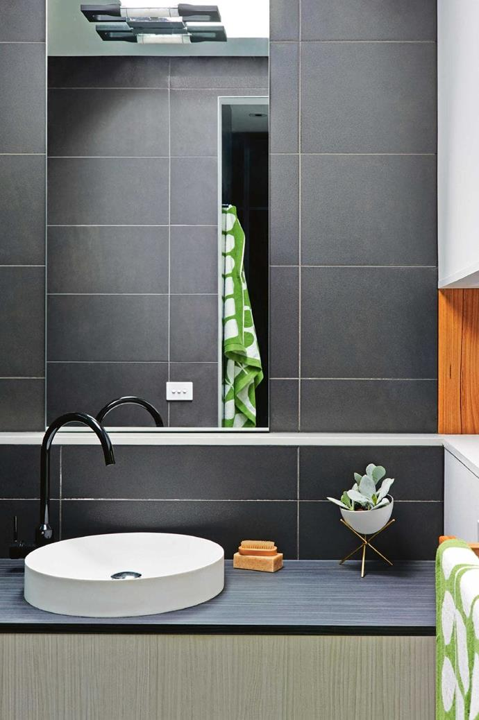 Large format grey tiles and a dark vanity deliver simplicity and luxury in this ensuite Stylist: Emma O'Meara, Photographer: Nikole Ramsay