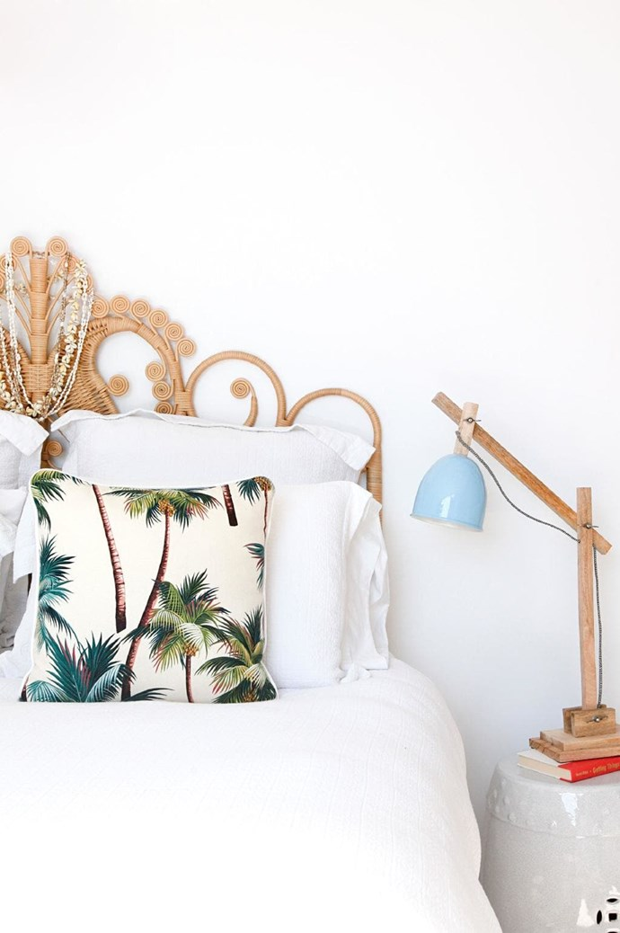 Get that holiday feeling every morning with a rattan bedhead and palm print cushions