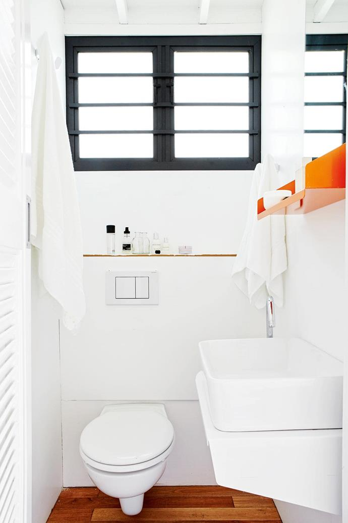 """**Careful planning** The bathroom is compact and contains the bare essentials. Even the shower has been moved to the hallway passage, with architect Clara da Cruz Almeida asking, """"Is it logical that a facility you use for five minutes a day should have a room by itself?"""" [Read the full story here](http://www.insideout.com.au/renovations/house/little-beauty-this-eclectic-home-takes-up-just-17-square-metres/news-story/f501fa9a8bf23f2e22921d1acc61e2f1). _Photography by Greg Cox_ Photographer: Greg Cox"""